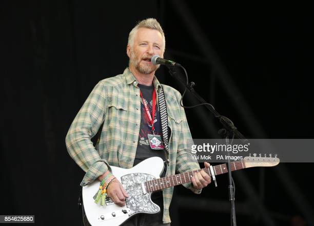 Billy Bragg singing on the Pyramid Stage before a performance by English National Ballet of 'Lest We Forget' about the First World War at the...