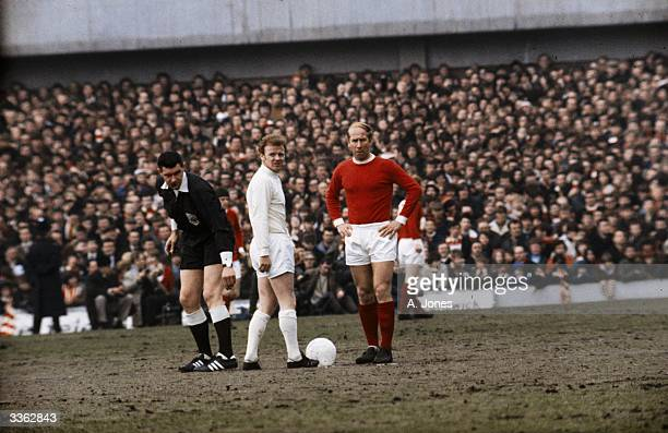 Billy Bremner of Leeds United and Bobby Charlton of Manchester United with referee Jack Taylor
