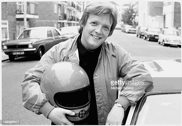 Billy Bremner of Rockpile portrait holding crash helmet London 1982