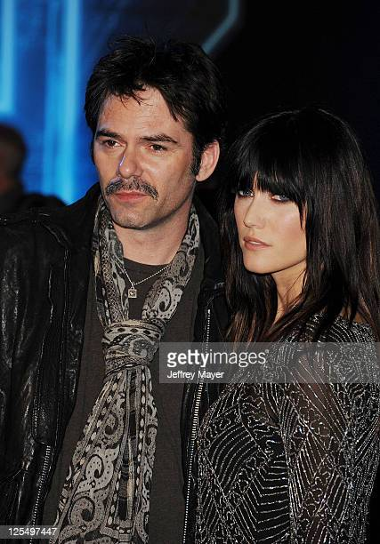 Billy Burke and guest arrive at the World Premiere of 'TRON Legacy' at the El Capitan Theatre on December 11 2010 in Hollywood California