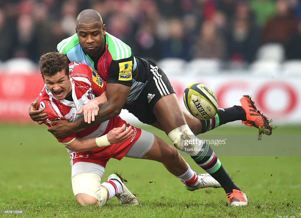 Billy Burns of Gloucester and Ugo Monye of Harlequins battle for the ball during the LV=Cup match between Gloucester Rugby and Harlequins at...