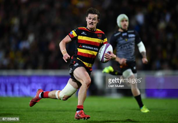 Billy Burns of Gloucester breaks away to score his side's first try during the European Rugby Challenge Cup Semi Final match between La Rochelle and...