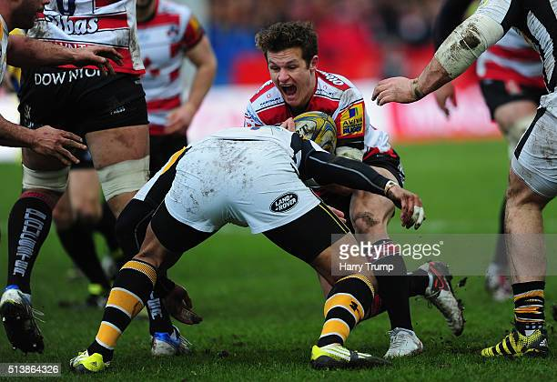 Billy Burns of Gloucester is tackled by Siale Piutau of Wasps during the Aviva Premiership match between Gloucester Rugby and Wasps at Kingsholm...
