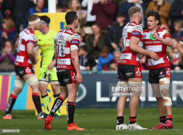 Billy Burns of Gloucester Rugby and his team mates celebrate victory during the Aviva Premiership match between Gloucester Rugby and Sale Sharks at...