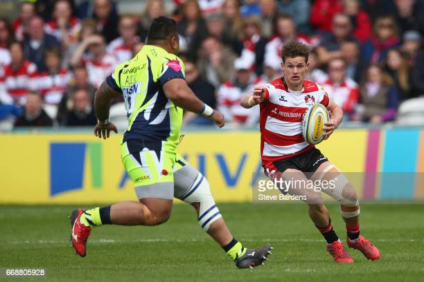 Billy Burns of Gloucester Rugby takes on Halani Aulika of Sale Sharks during the Aviva Premiership match between Gloucester Rugby and Sale Sharks at...