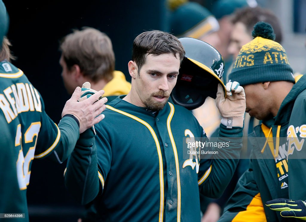 Billy Burns #1 of the Oakland Athletics celebrates after scoring against the Detroit Tigers during the ninth inning at Comerica Park on April 28, 2016 in Detroit, Michigan. The Tigers defeated the Athletics 7-3.