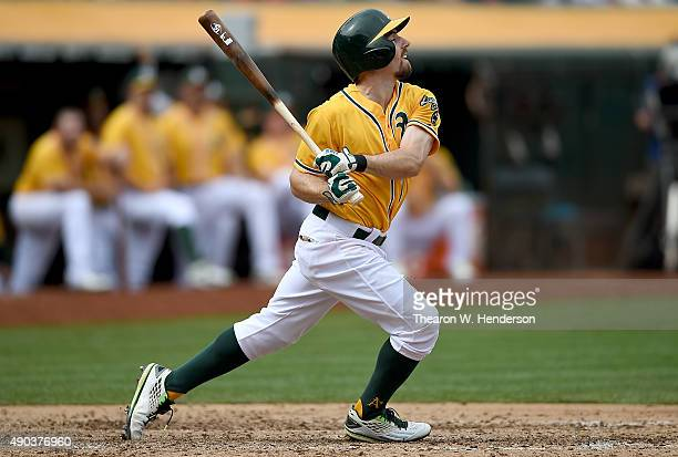 Billy Burns of the Oakland Athletics hits a tworun rbi double to short centerfield against the San Francisco Giants in the bottom of the fifth inning...