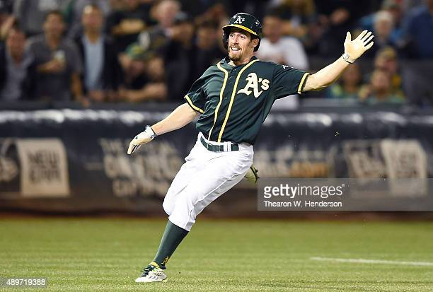 Billy Burns of the Oakland Athletics puts on the brakes between third base and home against the Texas Rangers in the bottom of the fifth inning at...