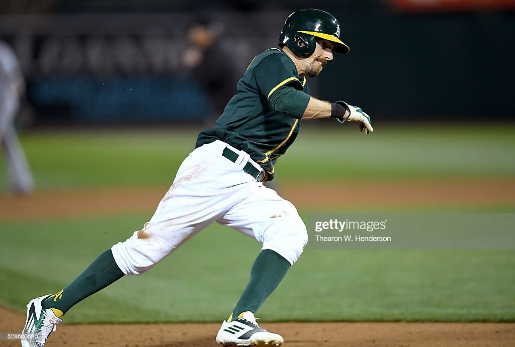 <a gi-track='captionPersonalityLinkClicked' href=/galleries/search?phrase=Billy+Burns+-+Baseball+Player+-+Born+1989&family=editorial&specificpeople=14686468 ng-click='$event.stopPropagation()'>Billy Burns</a> #1 of the Oakland Athletics rounds third base to score on an rbi single from Jed Lowrie #8 against the Seattle Mariners in the bottom of the six inning at O.co Coliseum on May 3, 2016 in Oakland, California.