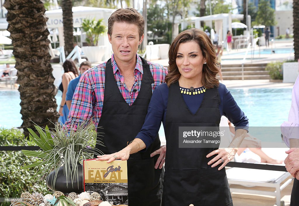 Billy Bush and Catherine 'Kit' Hoover attend Access Hollywood cabana at NAPTE 2013 at Fontainebleau Miami Beach on January 30, 2013 in Miami Beach, Florida.