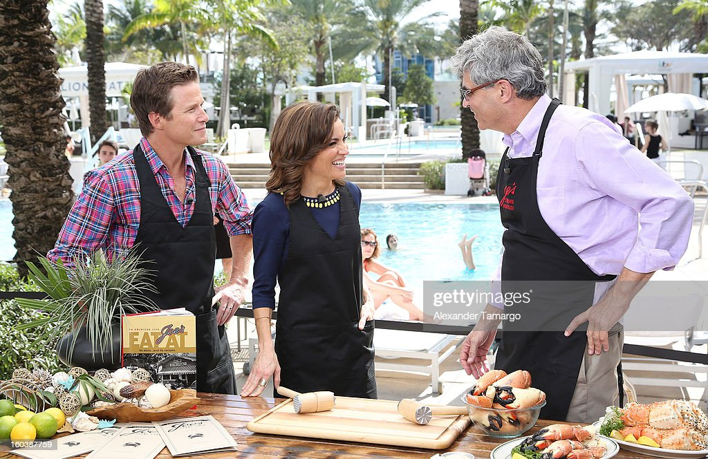 Billy Bush, Catherine 'Kit' Hoover and Steve Sawitz attend Access Hollywood cabana at NAPTE 2013 at Fontainebleau Miami Beach on January 30, 2013 in Miami Beach, Florida.