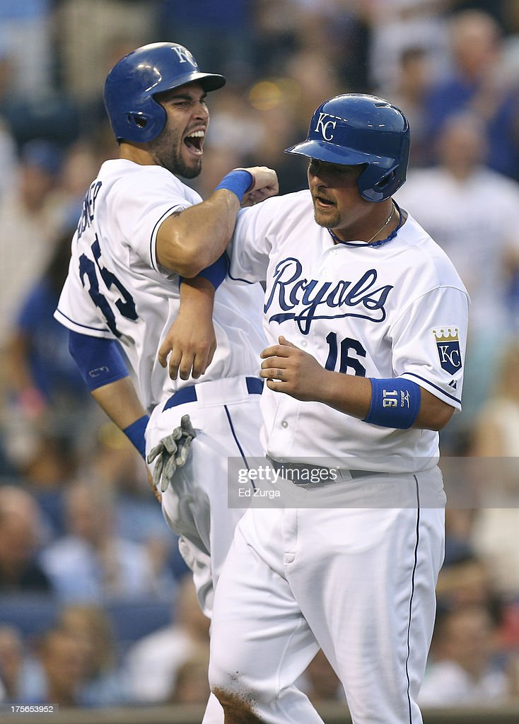 Billy Butler #16 and Eric Hosmer #35 of the Kansas City Royals celebrate after scoring on a Mike Moustakas single in the second inning during a game against the Minnesota Twins at Kauffman Stadium August, 5, 2013 in Kansas City, Missouri.
