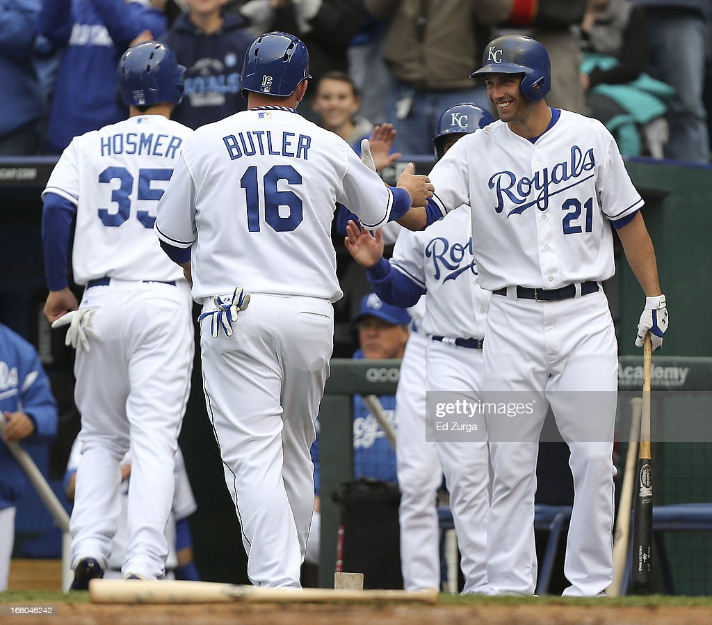 <a gi-track='captionPersonalityLinkClicked' href=/galleries/search?phrase=Billy+Butler&family=editorial&specificpeople=759092 ng-click='$event.stopPropagation()'>Billy Butler</a> #16 of the Kansas City Royals celebrates with <a gi-track='captionPersonalityLinkClicked' href=/galleries/search?phrase=Jeff+Francoeur&family=editorial&specificpeople=217574 ng-click='$event.stopPropagation()'>Jeff Francoeur</a> #21 after scoring on Lorenzo Cain's two-run triple against the Chicago White Sox in the first inning at Kauffman Stadium on May 4, 2013 in Kansas City, Missouri.
