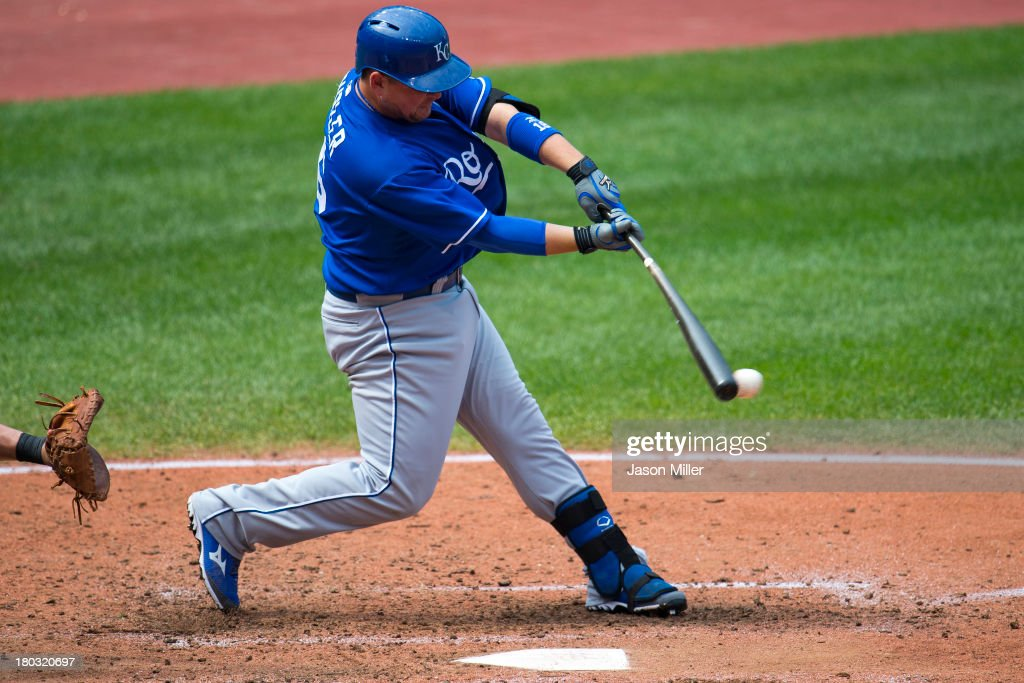 <a gi-track='captionPersonalityLinkClicked' href=/galleries/search?phrase=Billy+Butler&family=editorial&specificpeople=759092 ng-click='$event.stopPropagation()'>Billy Butler</a> #16 of the Kansas City Royals hits a sacrifice RBI ground ball for a double play during the fifth inning at Progressive Field on September 11, 2013 in Cleveland, Ohio. The Royals defeated the Indians 6-2.