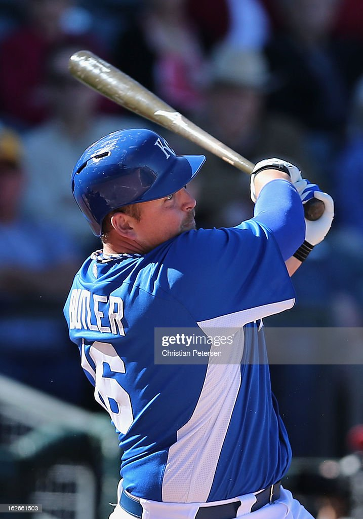 Billy Butler #16 of the Kansas City Royals hits a two RBI double against the Arizona Diamondbacks during the fourth inning of the spring training game at Surprise Stadium on February 25, 2013 in Surprise, Arizona.