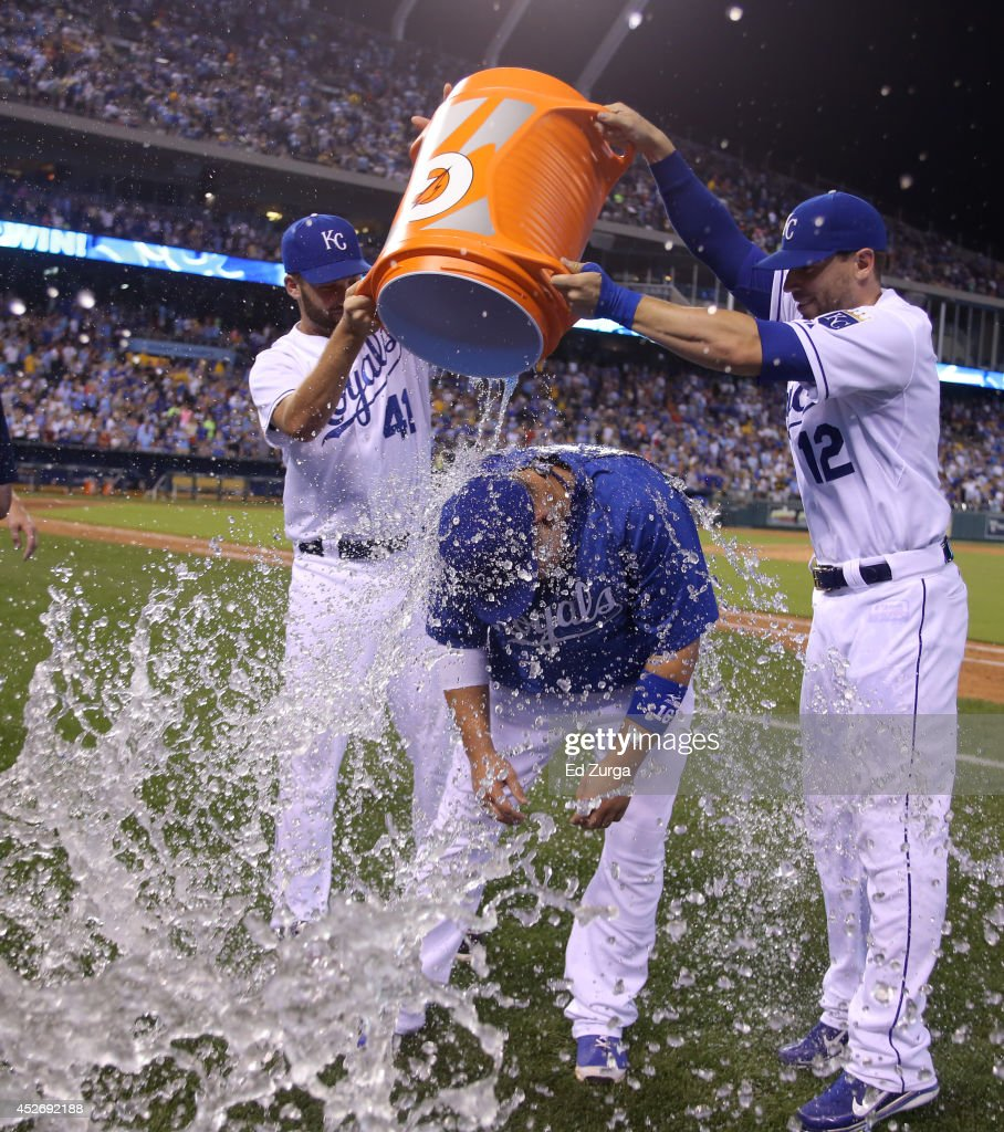 <a gi-track='captionPersonalityLinkClicked' href=/galleries/search?phrase=Billy+Butler&family=editorial&specificpeople=759092 ng-click='$event.stopPropagation()'>Billy Butler</a> #16 of the Kansas City Royals is doused with water by <a gi-track='captionPersonalityLinkClicked' href=/galleries/search?phrase=Danny+Duffy&family=editorial&specificpeople=5971971 ng-click='$event.stopPropagation()'>Danny Duffy</a> #41 and <a gi-track='captionPersonalityLinkClicked' href=/galleries/search?phrase=Brett+Hayes&family=editorial&specificpeople=795648 ng-click='$event.stopPropagation()'>Brett Hayes</a> #12 after a 6-4 win over the Cleveland Indians at Kauffman Stadium on July 25, 2014 in Kansas City, Missouri.