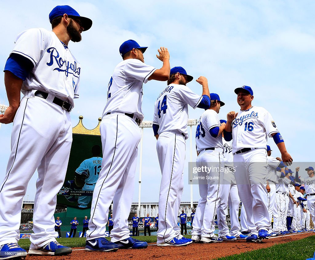 Billy Butler #16 of the Kansas City Royals is greeted by teammates during player introductions prior to the Kansas City Royals home opener against the Minnesota Twins at Kauffman Stadium on April 8, 2013 in Kansas City, Missouri.
