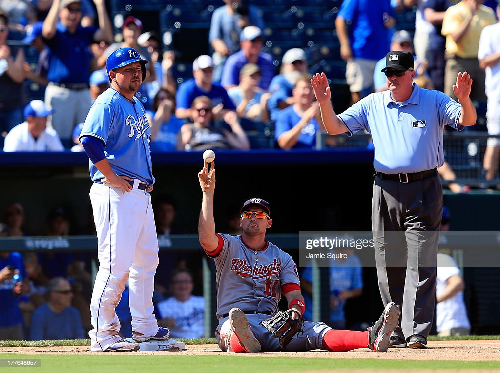 <a gi-track='captionPersonalityLinkClicked' href=/galleries/search?phrase=Billy+Butler&family=editorial&specificpeople=759092 ng-click='$event.stopPropagation()'>Billy Butler</a> #16 of the Kansas City Royals is safe at third on a fielder's choice as <a gi-track='captionPersonalityLinkClicked' href=/galleries/search?phrase=Ryan+Zimmerman+-+Baseball+Player&family=editorial&specificpeople=534809 ng-click='$event.stopPropagation()'>Ryan Zimmerman</a> #11 of the Washington Nationals returns the ball to the pitcher during the 8th inning of the game at Kauffman Stadium on August 25, 2013 in Kansas City, Missouri.