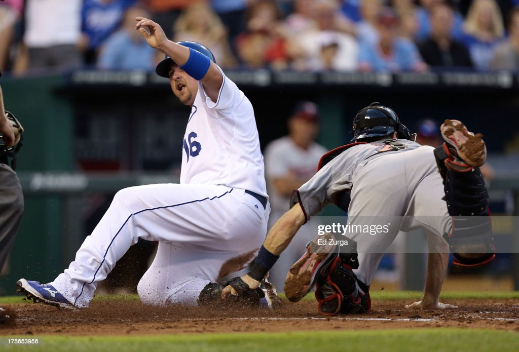 <a gi-track='captionPersonalityLinkClicked' href=/galleries/search?phrase=Billy+Butler&family=editorial&specificpeople=759092 ng-click='$event.stopPropagation()'>Billy Butler</a> #16 of the Kansas City Royals slides past <a gi-track='captionPersonalityLinkClicked' href=/galleries/search?phrase=Joe+Mauer&family=editorial&specificpeople=214614 ng-click='$event.stopPropagation()'>Joe Mauer</a> #7 of the Minnesota Twins as he scores in the second inning at Kauffman Stadium August, 5, 2013 in Kansas City, Missouri.