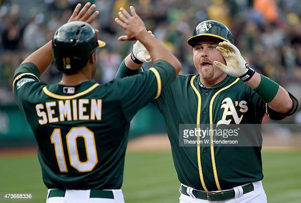 Billy Butler of the Oakland Athletics is congratulated by Marcus Semien after Butler hit a tworun homer against the Chicago White Sox in the bottom...