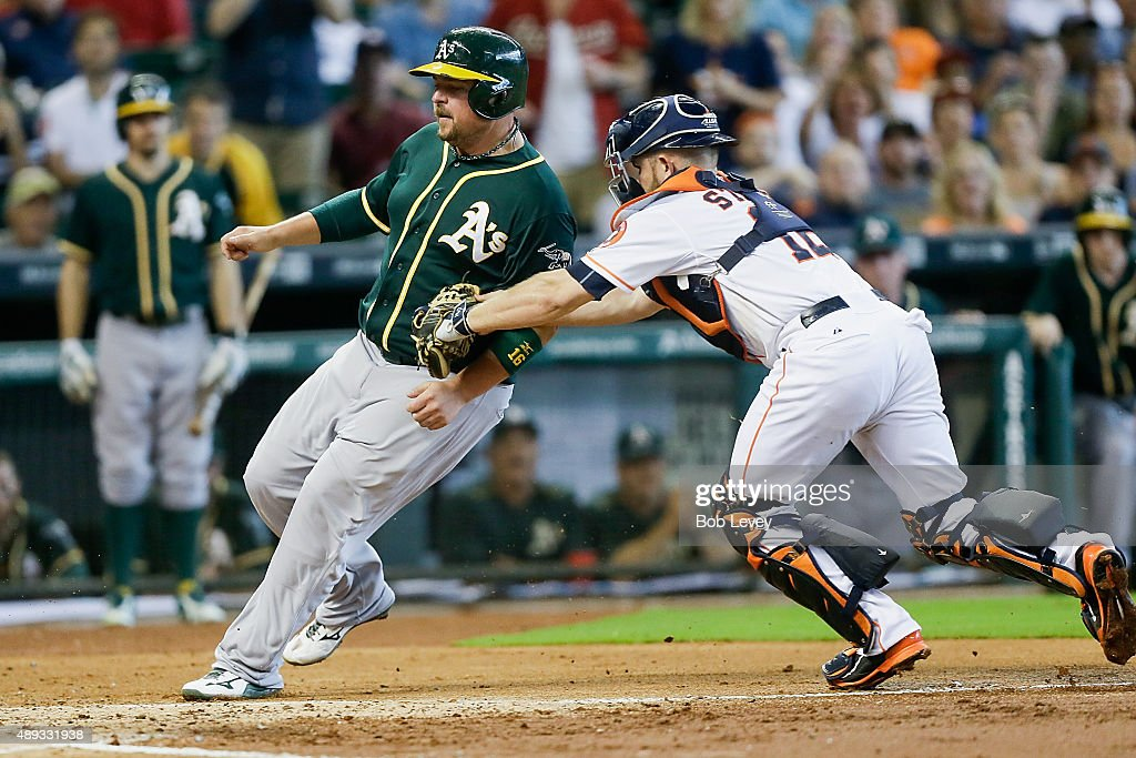 <a gi-track='captionPersonalityLinkClicked' href=/galleries/search?phrase=Billy+Butler&family=editorial&specificpeople=759092 ng-click='$event.stopPropagation()'>Billy Butler</a> #16 of the Oakland Athletics is tagged out by Max Stassi #12 of the Houston Astros trying to score in the second inning at Minute Maid Park on September 20, 2015 in Houston, Texas.