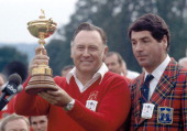 Billy Casper nonplaying captain of the United States team with the trophy and National PGA President Frank Cardi after the American team won the...
