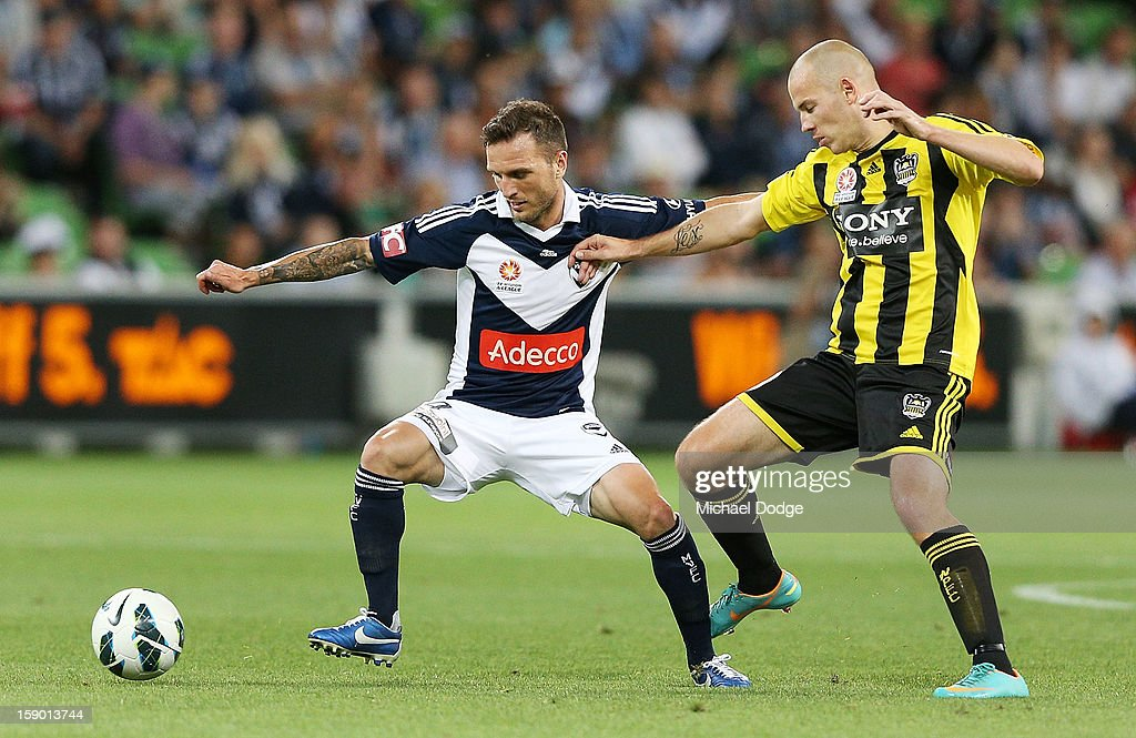 Billy Celeski (L) of the Melbourne Victory contests for the ball against Stein Huysegems of the Wellington Phoenix during the round 15 A-League match between the Melbourne Victory and Wellington Phoenix at AAMI Park on January 5, 2013 in Melbourne, Australia.