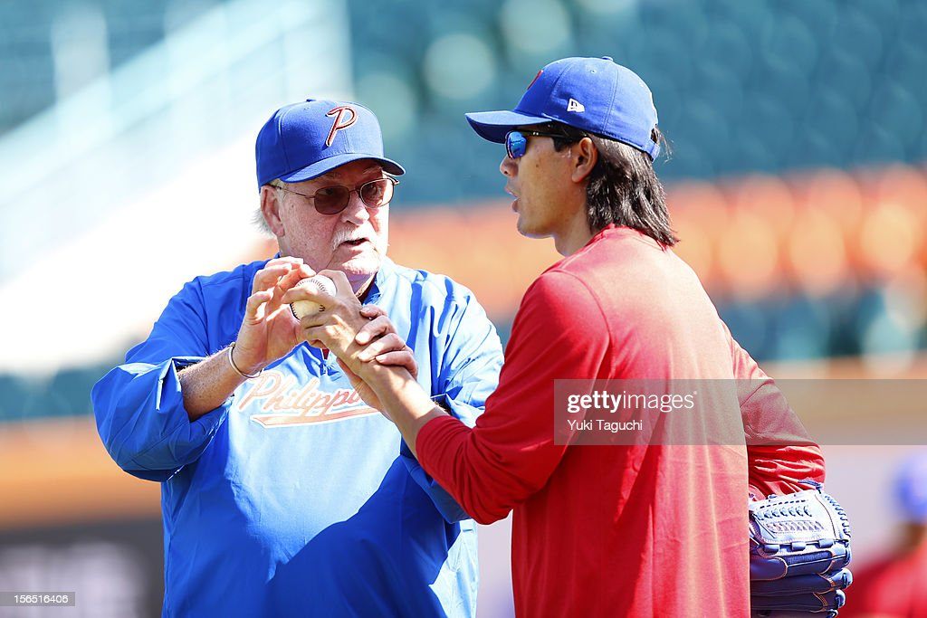 Billy Champion coach of Team Philippines talks pitching with Geno Espinelli of Team Philippines during the workout day for the 2013 World Baseball Classic Qualifier at Xinzhuang Stadium on November 14, 2012 in New Taipei City, Taiwan.