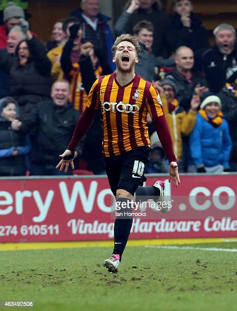 Billy Clarke of Bradford City celebrates after his shot on goal deflected off John O'Shea of Sunderland into the net putting Bradford in front during...