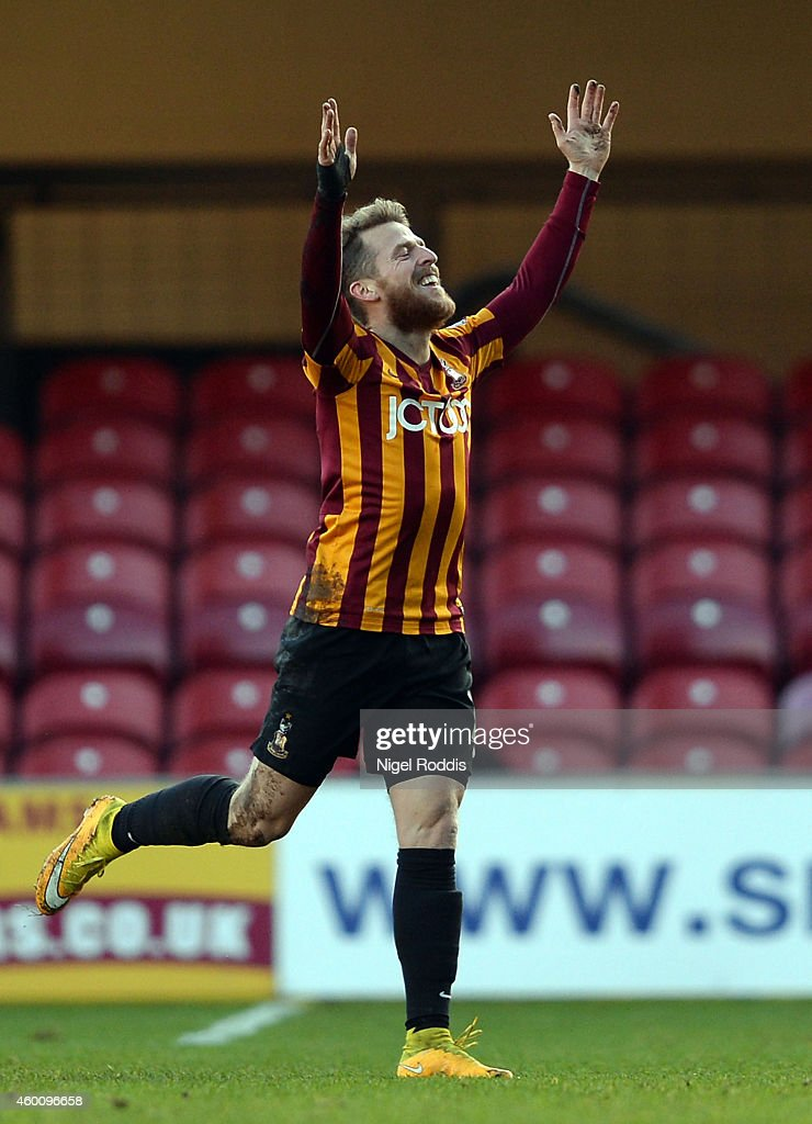 Billy Clarke of Bradford City celebrates scoring the first goal during the FA Cup Second Round football match between Bradford City and Dartford at Coral Windows Stadium, Valley Parade on December 7, 2014 in Bradford, England.
