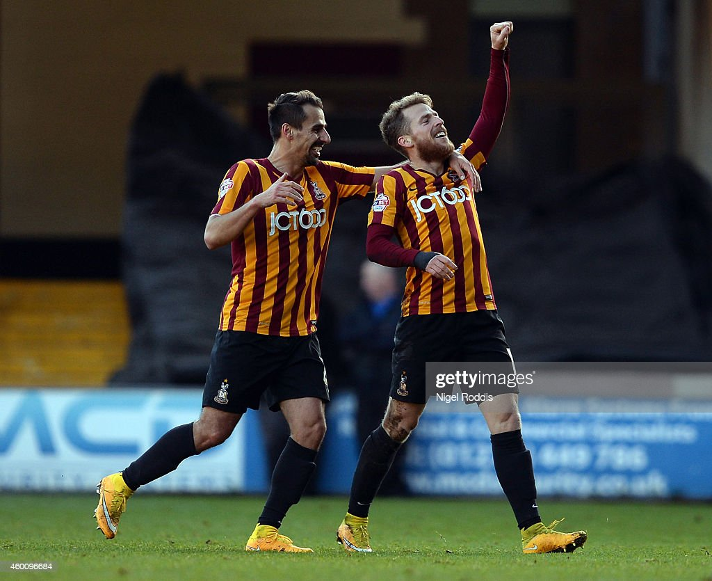 Billy Clarke of Bradford City celebrates scoring with Stephen Darby during the FA Cup Second Round football match between Bradford City and Dartford at Coral Windows Stadium, Valley Parade on December 7, 2014 in Bradford, England.