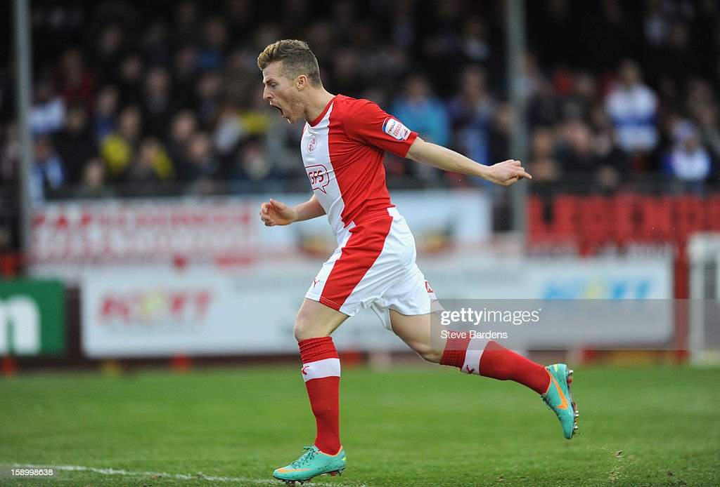 Billy Clarke of Crawley Town celebrates the opening goal scored by team mate Nicky Adams during the FA Cup with Budweiser Third Round match between Crawley Town and Reading at Broadfield Stadium on January 5, 2013 in Crawley, West Sussex.