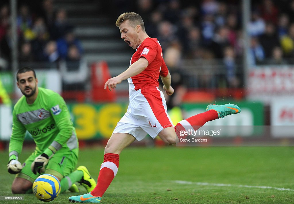 Billy Clarke of Crawley Town celebrates the opening goal scored by team mate Nicky Adams as <a gi-track='captionPersonalityLinkClicked' href=/galleries/search?phrase=Adam+Federici&family=editorial&specificpeople=886953 ng-click='$event.stopPropagation()'>Adam Federici</a> of Reading despairs during the FA Cup with Budweiser Third Round match between Crawley Town and Reading at Broadfield Stadium on January 5, 2013 in Crawley, West Sussex.