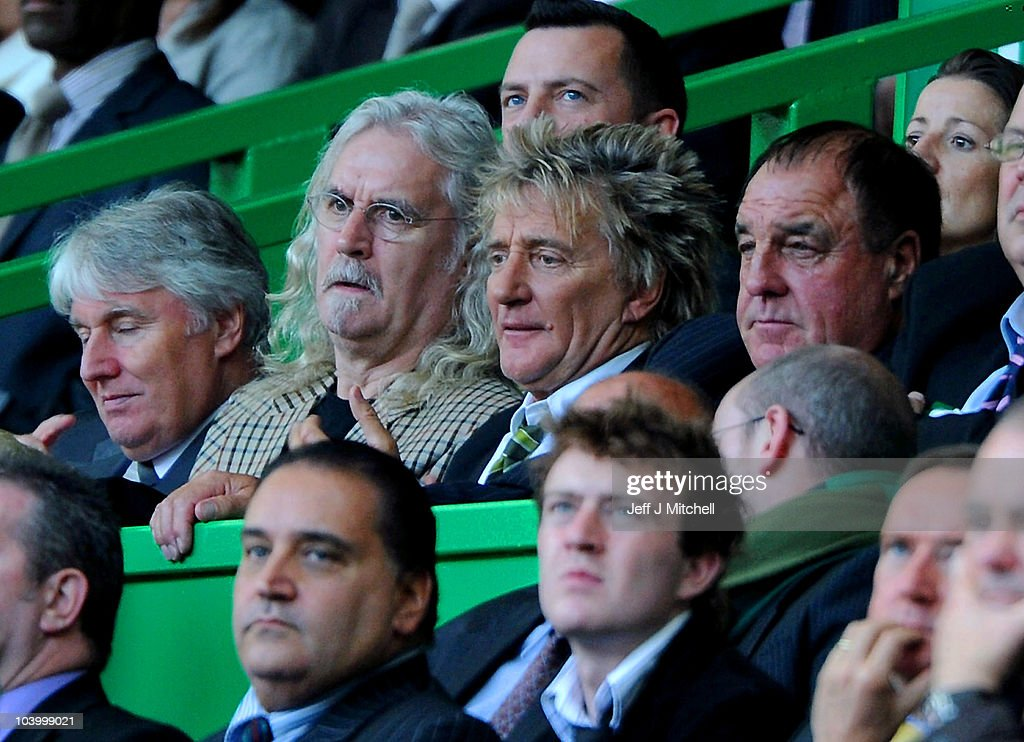Billy Connolly and Rod Stewart watch from the stand during the Clydesdale Bank Premier League match between Celtic and Hearts at Celtic Park on September 11, 2010 in Glasgow, Scotland.