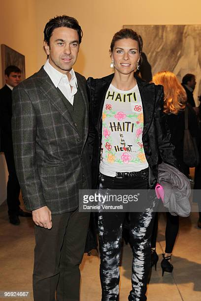 Billy Costacurta and Martina Colombari attend the Jorg Immendorff show at the Cardi Black Box Gallery on January 21 2010 in Milan Italy