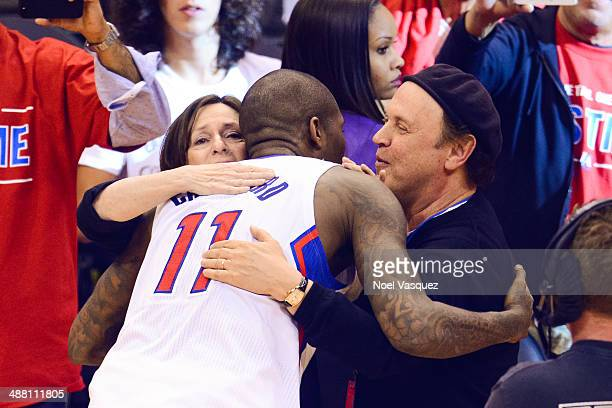 Billy Crystal and Janice Crystal hug Jamal Crawford at an NBA playoff game between the Golden State Warriors and the Los Angeles Clippers at Staples...