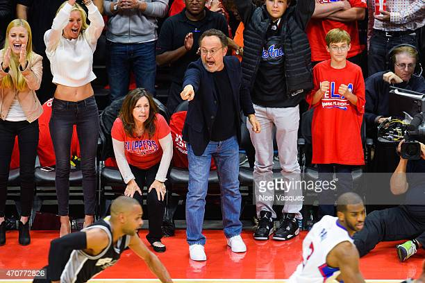 Billy Crystal attends a basketball game between the San Antonio Spurs and the Los Angeles Clippers at Staples Center on April 22 2015 in Los Angeles...