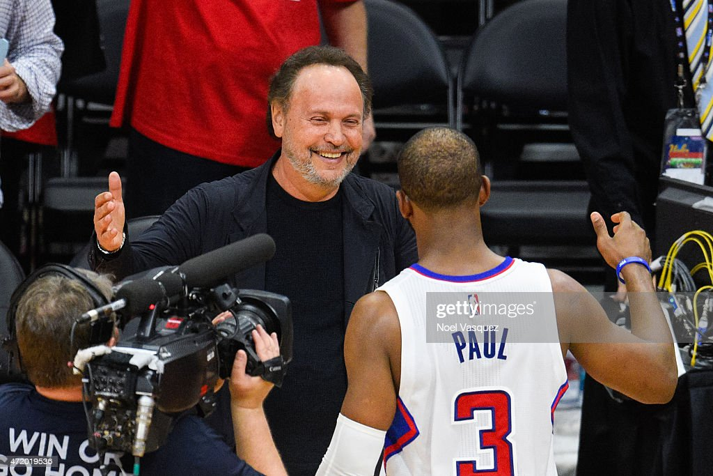 Billy Crystal greets Chris Paul after a basketball game between the San Antonio Spurs and Los Angeles Clippers at Staples Center on May 2 2015 in Los...