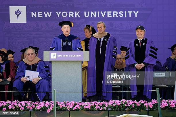 Billy Crystal looks on as NYU president Andrew Hamilton speaks during the 2016 New York University Commencement Ceremony at Yankee Stadium on May 18...