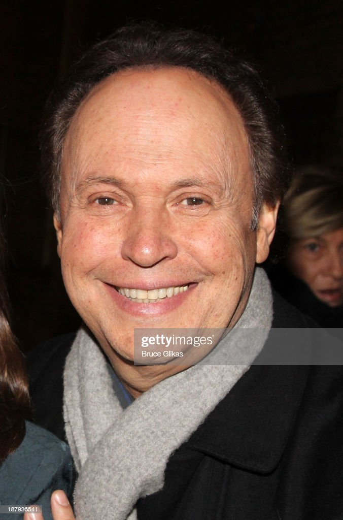 Billy Crystal poses at the '700 Sundays' opening night welcome back to Broadway celebration at The Imperial Theatre on November 13, 2013 in New York City.
