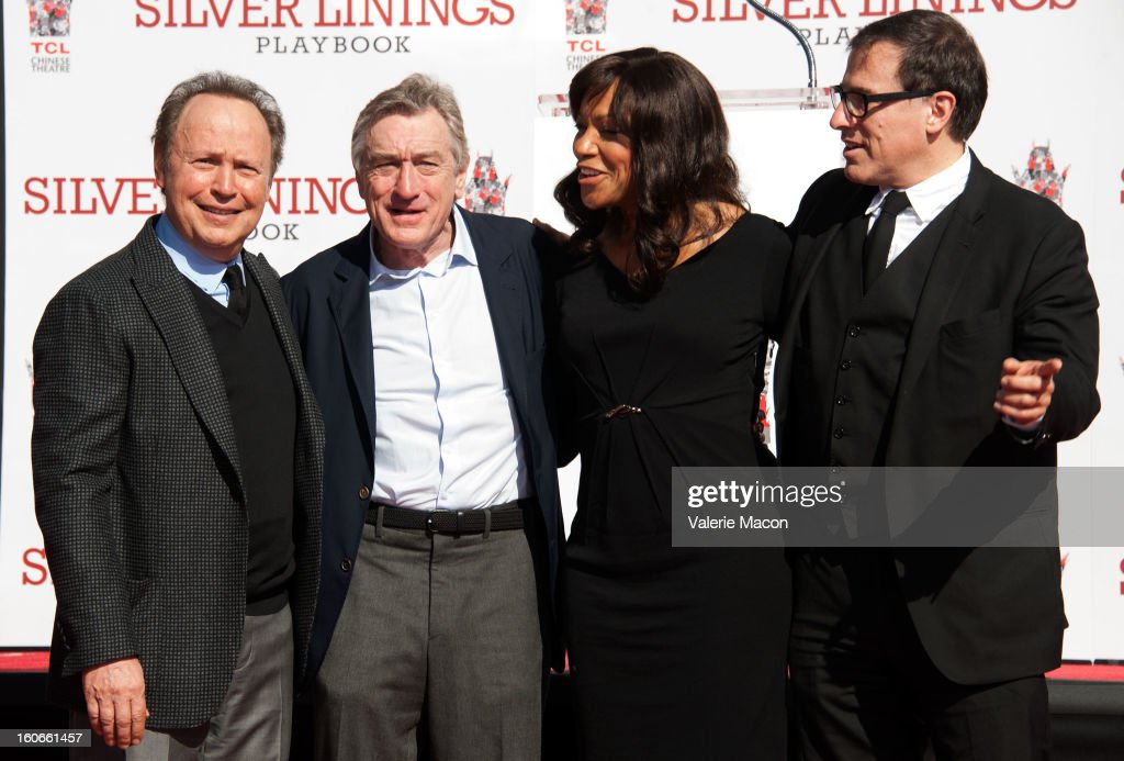 <a gi-track='captionPersonalityLinkClicked' href=/galleries/search?phrase=Billy+Crystal&family=editorial&specificpeople=202497 ng-click='$event.stopPropagation()'>Billy Crystal</a>, Robert De Niro and Grace Hightower and David O. Russel attend Robert De Niro Hand and Footprint Ceremony at TCL Chinese Theatre on February 4, 2013 in Hollywood, California.