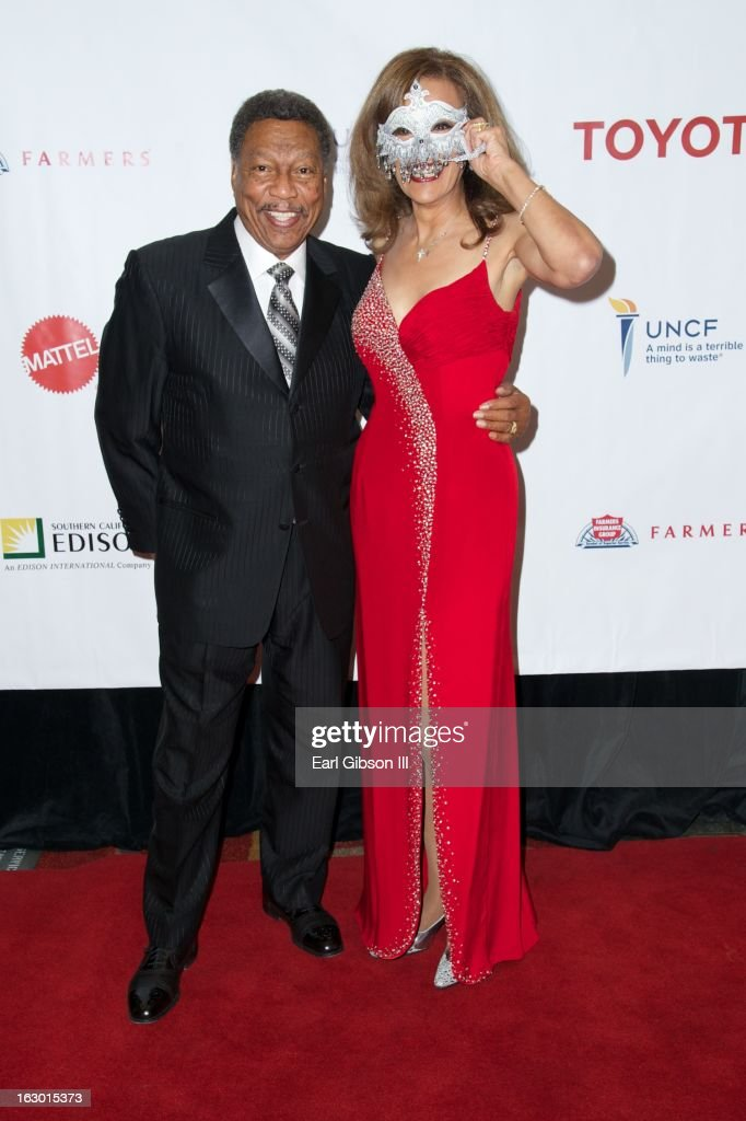 Billy Davis Jr and Marily McCoo pose for a photo on the red carpet at the UNCF Mayor's Masked Ball Hosted By Mayor Antonio Villaraigosa at Hilton Universal City on March 2, 2013 in Universal City, California.