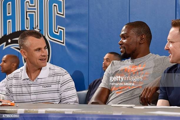 Billy Donovan and Kevin Durant of the Oklahoma City Thunder sit on the sideline during a game against the Charlotte Hornets on July 4 2015 at Amway...