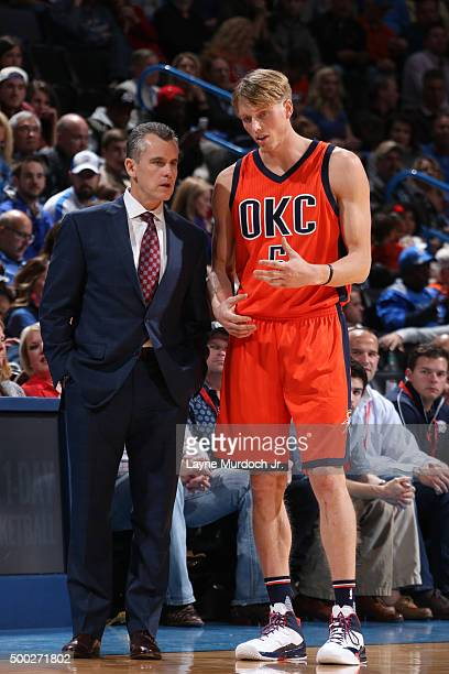 Billy Donovan and Kyle Singler of the Oklahoma City Thunder during the game against the Sacramento Kings on December 6 2015 at the Chesapeake Energy...
