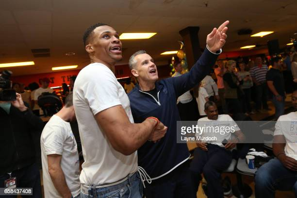 Billy Donovan and Russell Westbrook of the Oklahoma City Thunder react to a frame during his 7th annual Why Not Foundation bowling event on March 24...