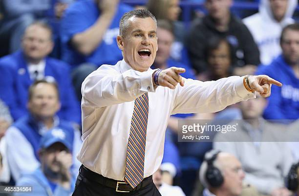 Billy Donovan the head coach of the Florida Gators gives instructions to his team during the game against the Kentucky Wildcats at Rupp Arena on...