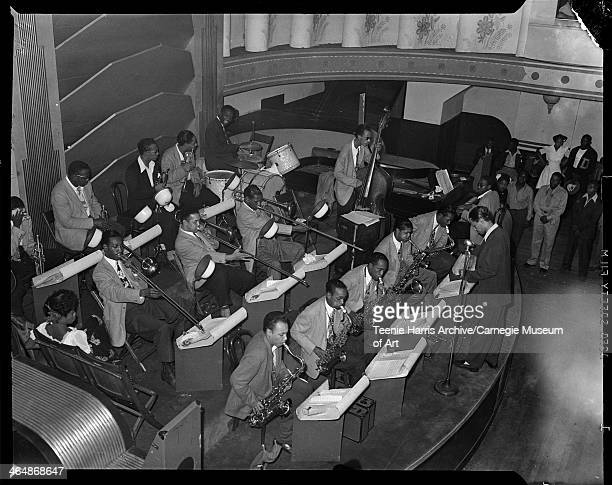 Billy Eckstine conducting his orchestra with Charlie Parker on saxophone third from left Dizzy Gillespie Art Blakey on drums Sarah Vaughan seated on...