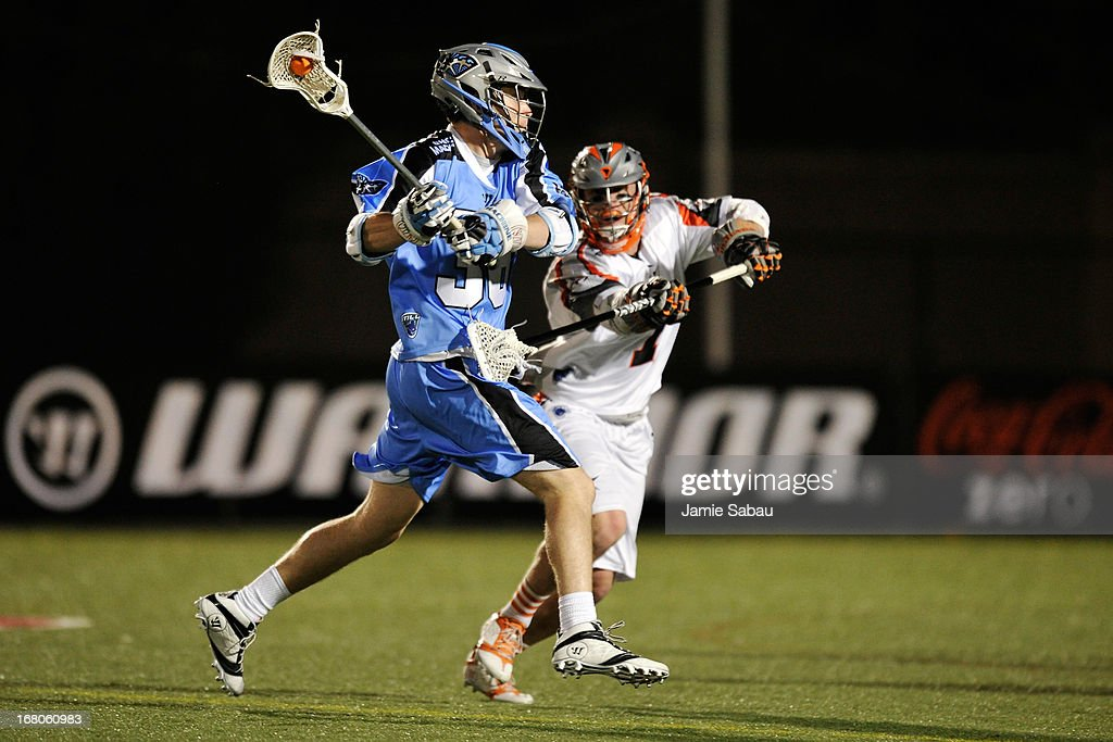 Billy Eisenreich #36 of the Ohio Machine controls the ball in the second half as Matt Bocklet #7 of the Denver Outlaws defends on May 4, 2013 at Selby Stadium in Delaware, Ohio. Denver defeated Ohio 13-8.