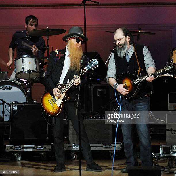 Billy F Gibbons of ZZ Top and Steve Earle performs at The Music of David Byrne Talking Heads at Carnegie Hall on March 23 2015 in New York City
