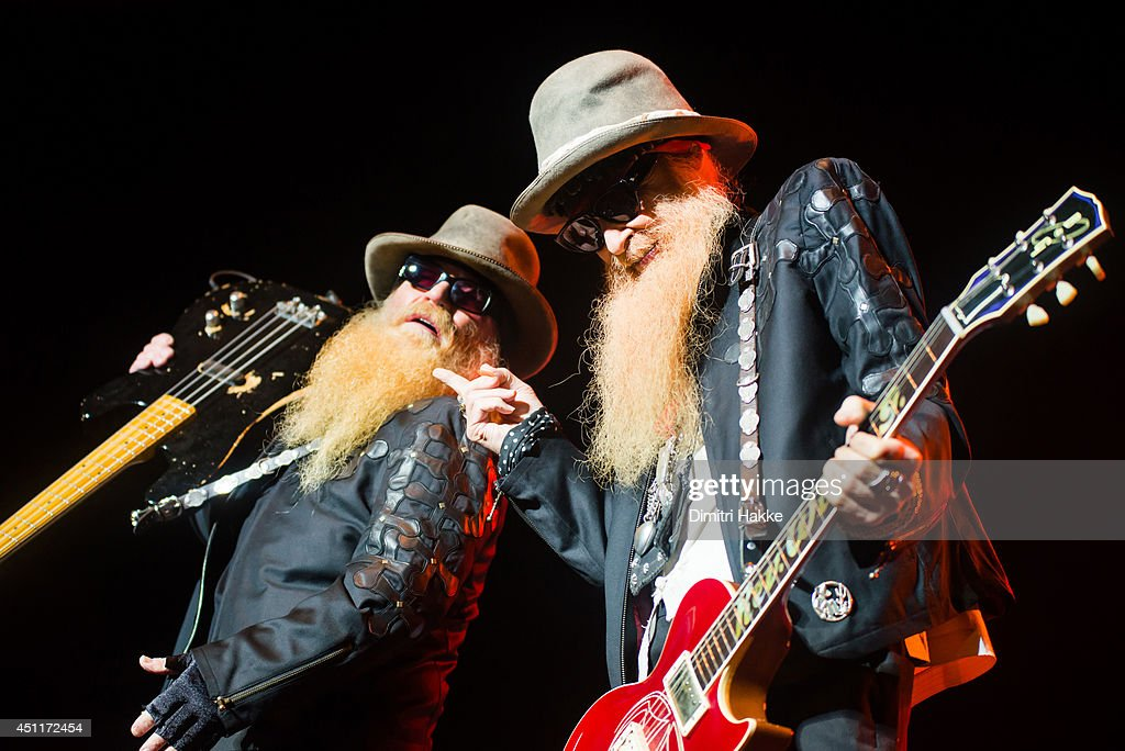 <a gi-track='captionPersonalityLinkClicked' href=/galleries/search?phrase=Billy+Gibbons&family=editorial&specificpeople=242873 ng-click='$event.stopPropagation()'>Billy Gibbons</a> and <a gi-track='captionPersonalityLinkClicked' href=/galleries/search?phrase=Dusty+Hill&family=editorial&specificpeople=589350 ng-click='$event.stopPropagation()'>Dusty Hill</a> of ZZ Top perform on stage at Heineken Music Hall on June 24, 2014 in Amsterdam, Netherlands.